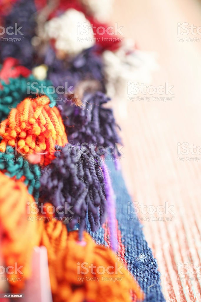 Traditional colorful pompoms stock photo