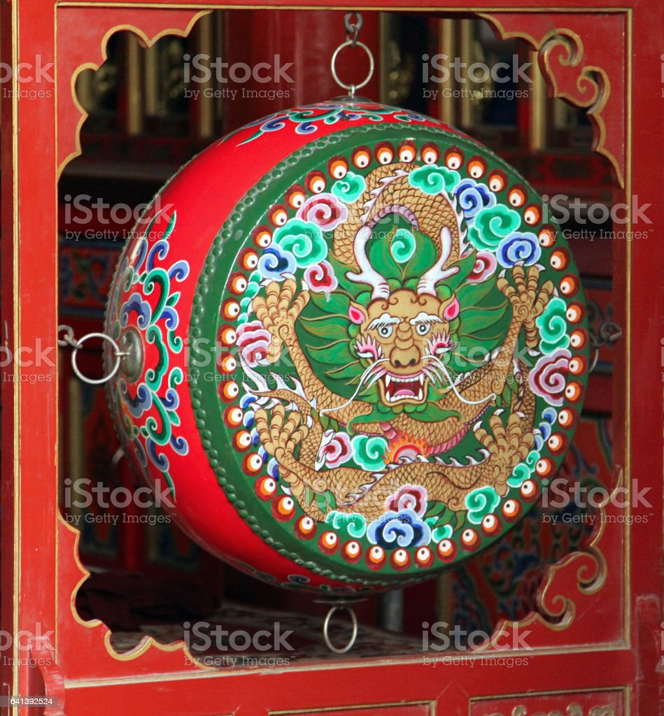 Hohhot, Inner Mongolia - JUl 8, 2011: Traditional colorful prayer drum in buddhist monastery stock photo