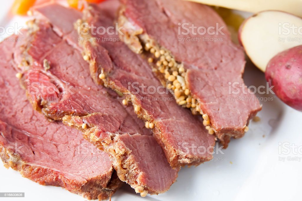 Traditional corned beef and cabbage in a slow cooker stock photo