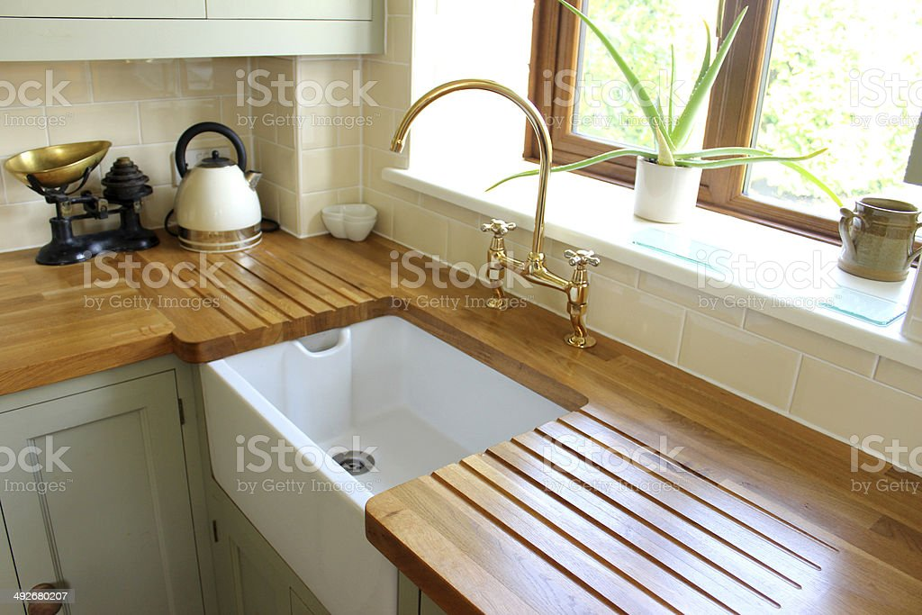Traditional country kitchen, white Belfast ceramic sink with wooden worktops stock photo