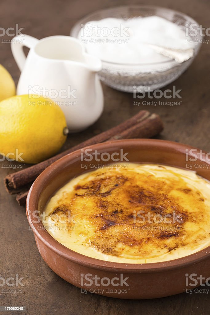 Traditional creme brulee on ceramic dish royalty-free stock photo