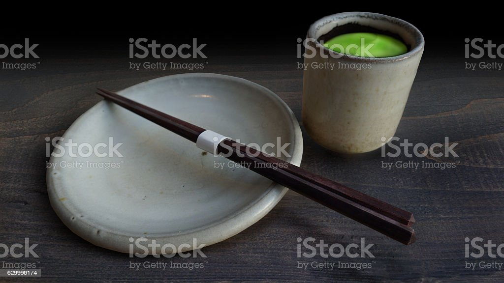 Traditional cup of green tea and blank plate stock photo
