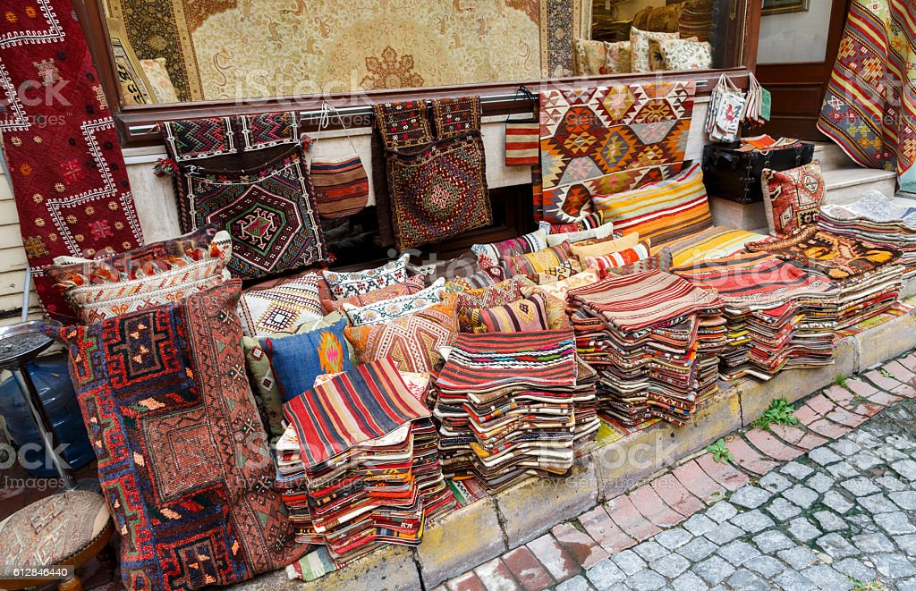 Traditional cushions and carpets in street of Istanbul,Turkey. stock photo