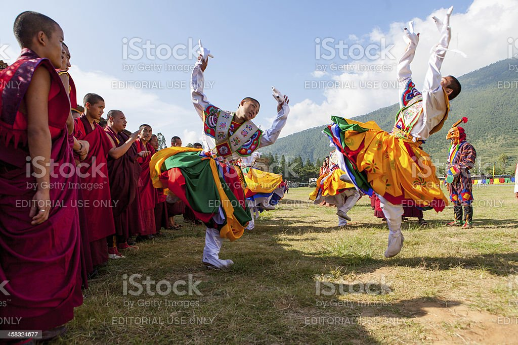 Traditional dancers prepare for their act at the Wangdi Festival stock photo