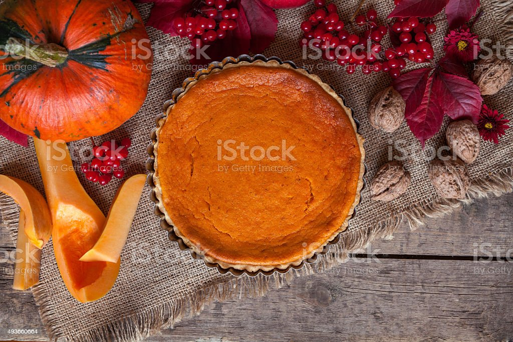 Traditional delicious pumpkin tart pie dessert food  with nuts and stock photo