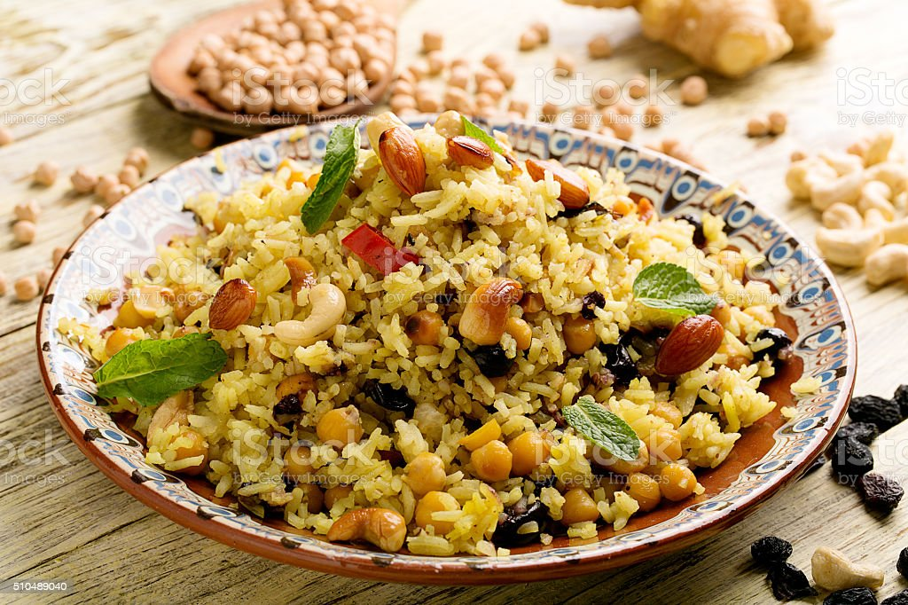 Traditional dish of rice (pilaf) cooked with spices stock photo