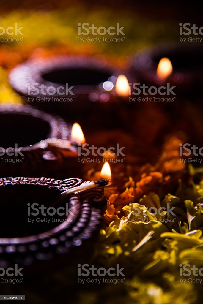 traditional diya in diwali festival over flower rangoli stock photo