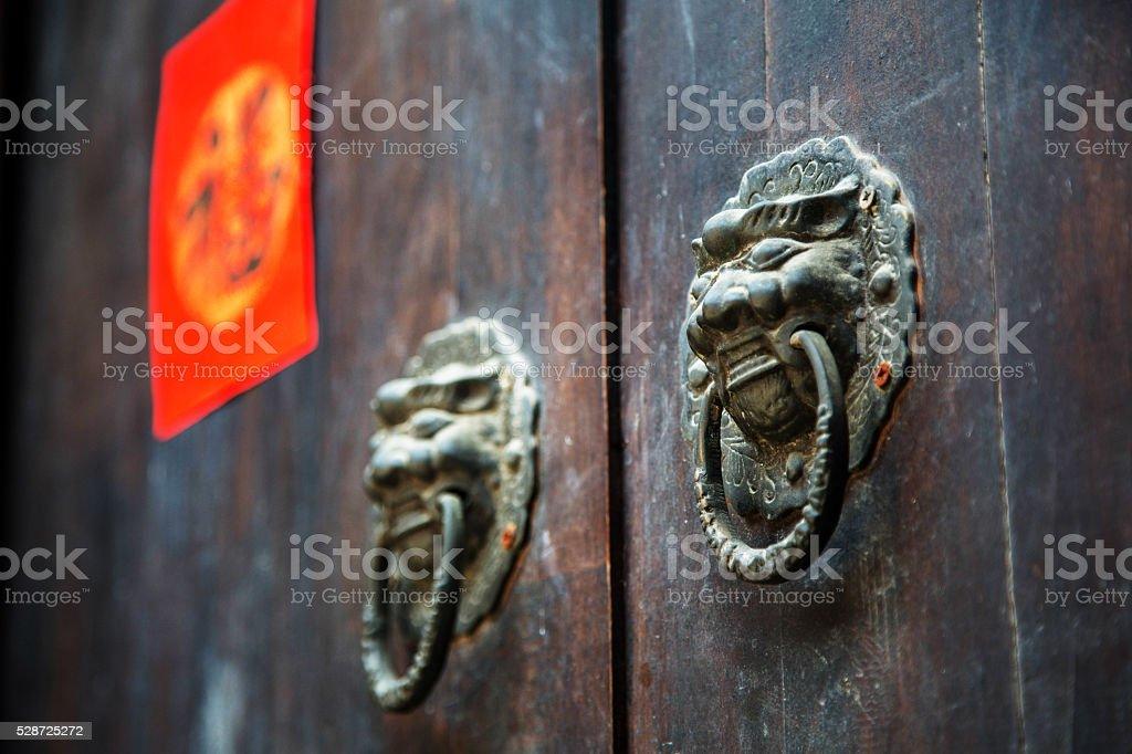 traditional dragon knocker on old door stock photo