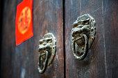 traditional dragon knocker on old door