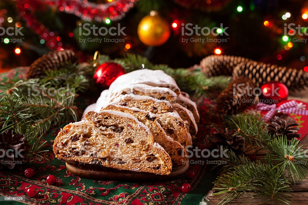 Traditional Dresdner German Christmas cake Stollen with raising, berries and stock photo