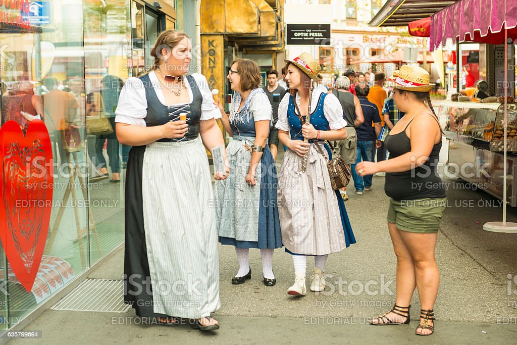 Traditional dress on Villacher Kirchtag costume paradein stock photo