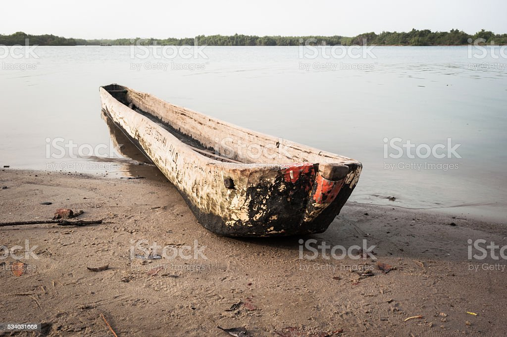 Traditional dugout wooden canoe on the Mono's river shore, Benin stock photo