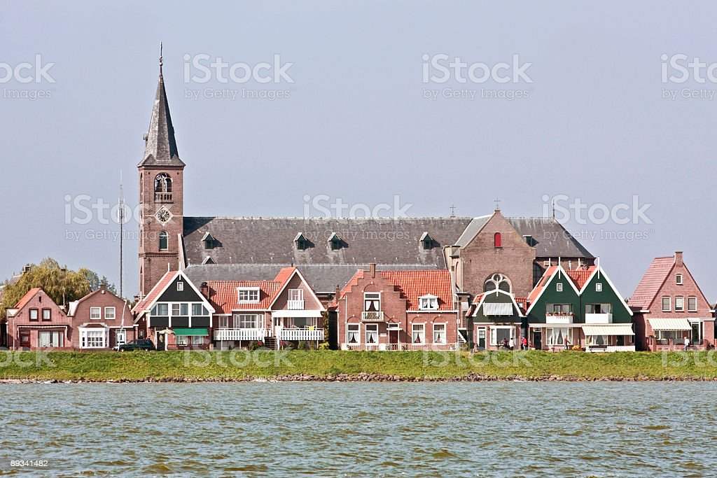Traditional dutch church and houses in Volendam Netherlands stock photo