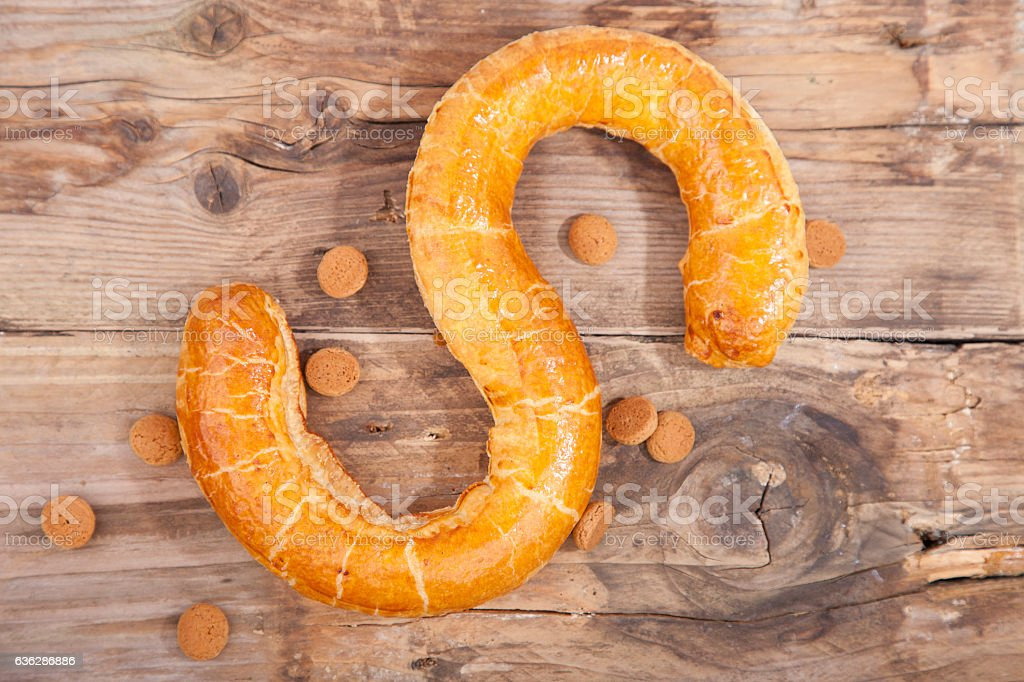 Traditional Dutch cookie Banketletter at Sinterklaas celebration on wooden background stock photo