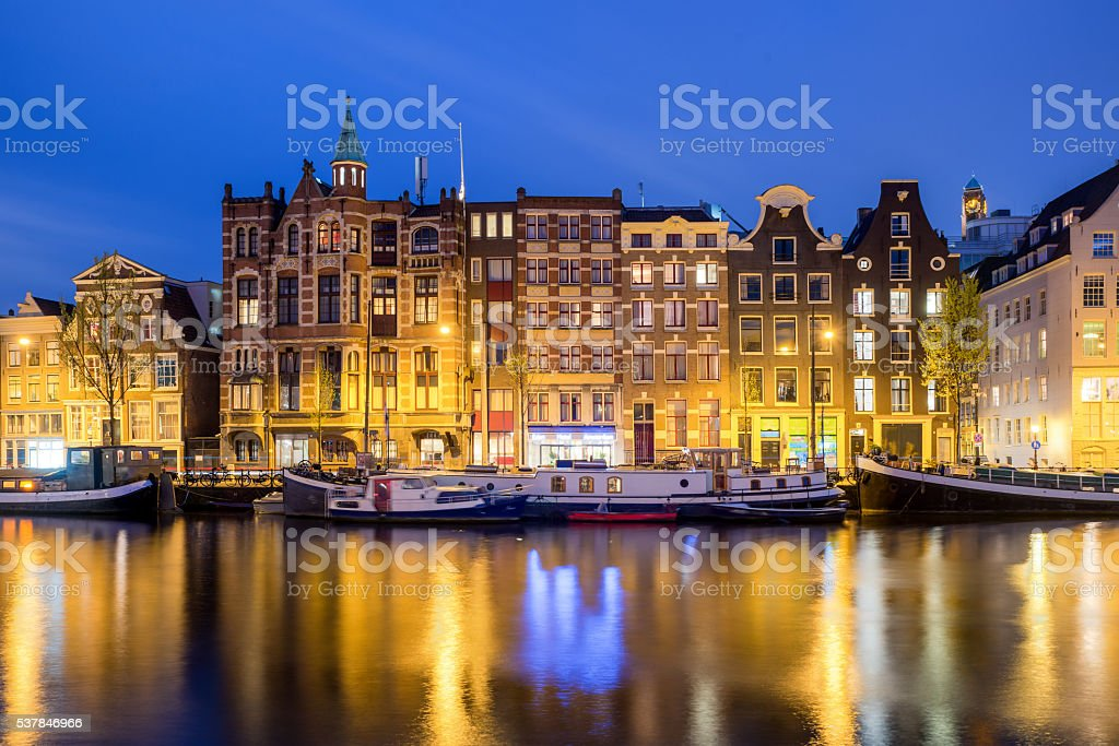 Traditional Dutch houses in Amsterdam, Netherlands. stock photo