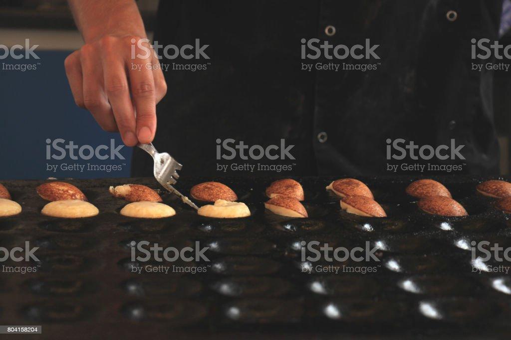 Traditional Dutch Poffertjes stock photo