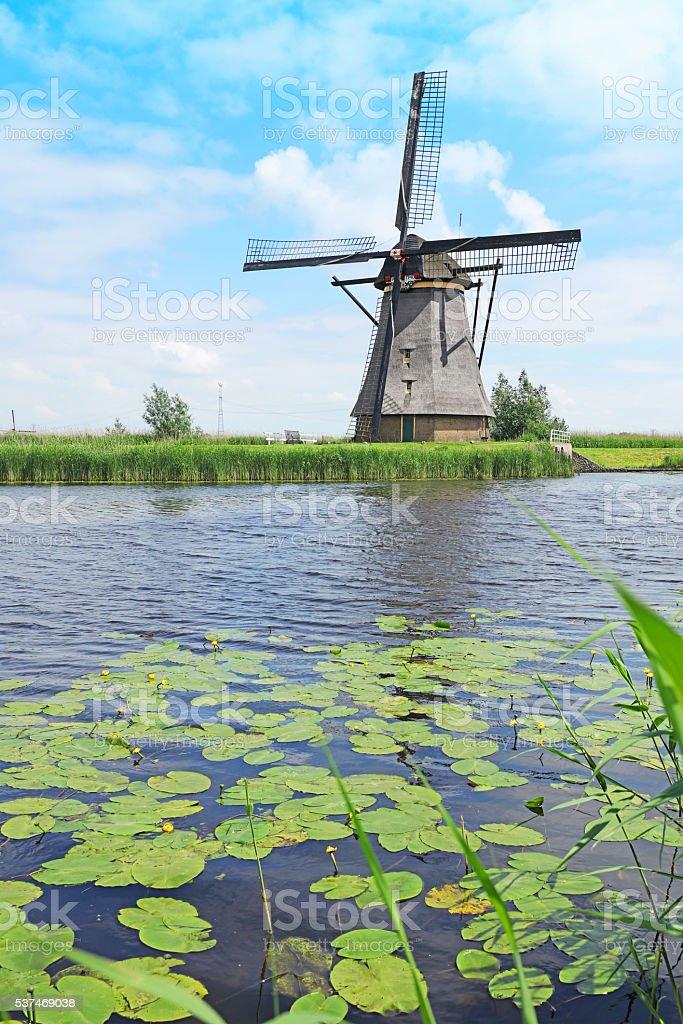 Traditional Dutch Windmill at Kinderdijk in the Netherlands stock photo