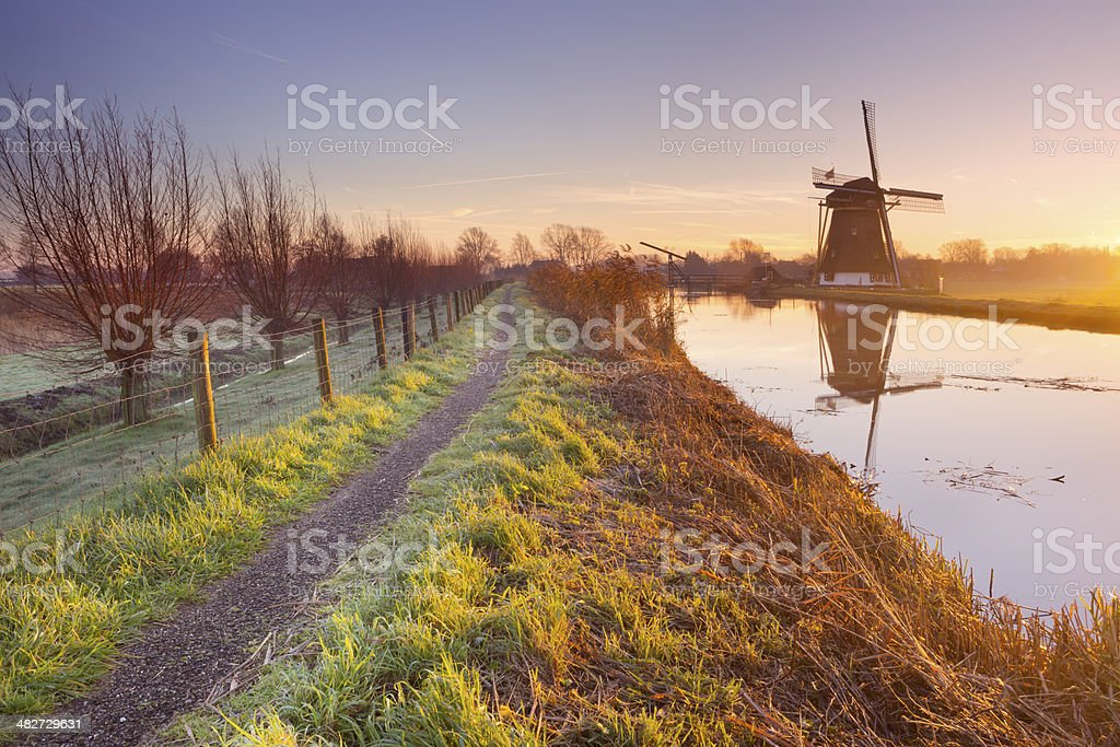 Traditional Dutch windmill near Abcoude, The Netherlands at sunrise stock photo