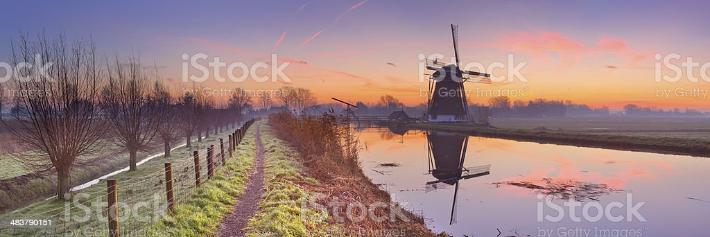 Traditional Dutch windmill near Abcoude, The Netherlands at sunrise royalty-free stock photo