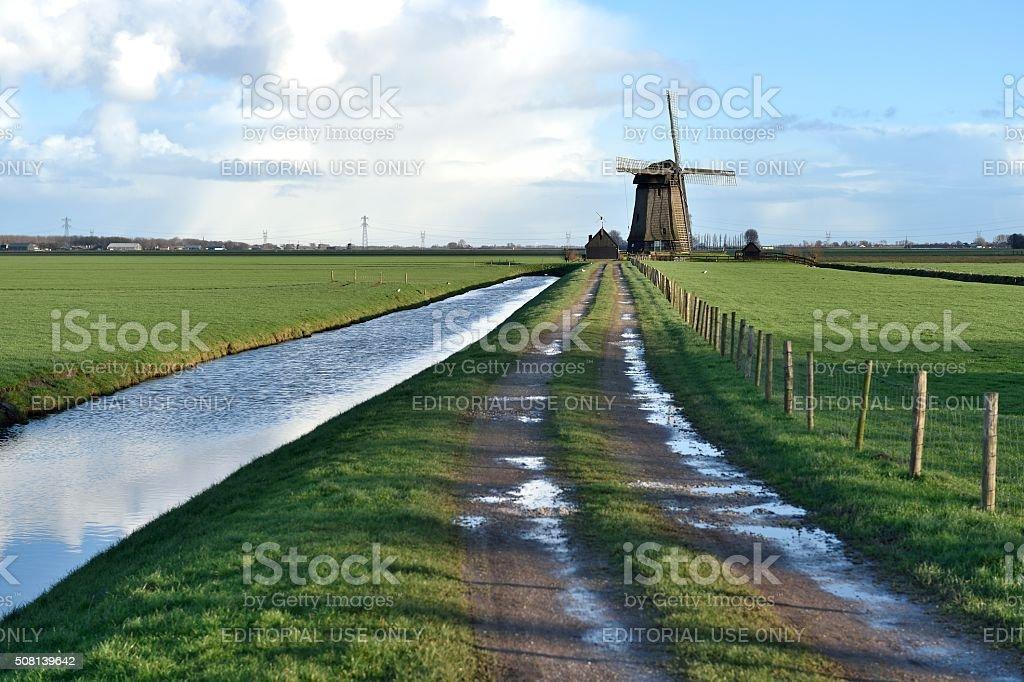 Traditional Dutch windmill near Stompetoren stock photo