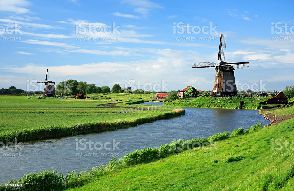 Traditional Dutch Windmill on a canal stock photo