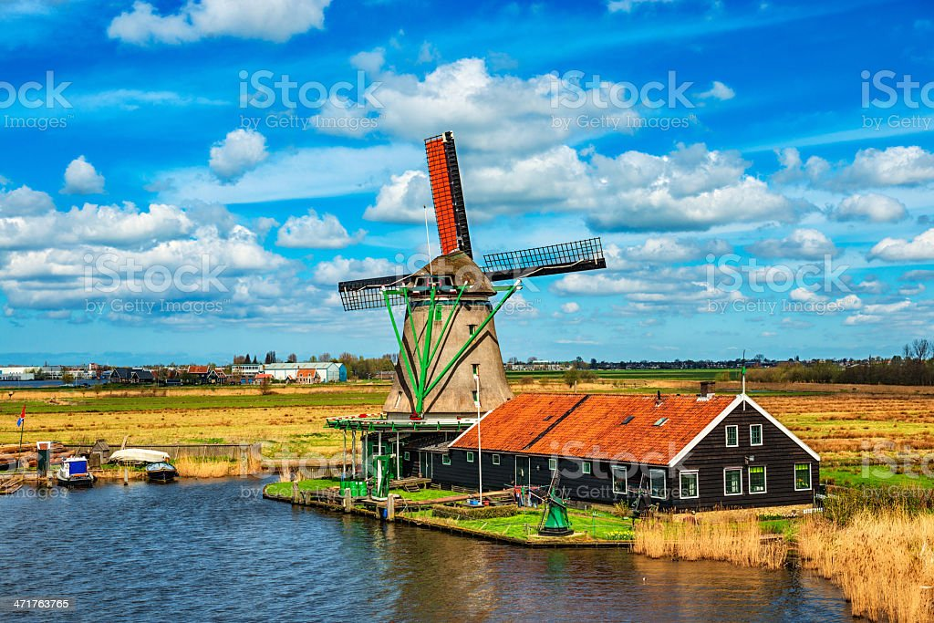 Traditional Dutch Windmill on a Typical Canal in Netherlands stock photo