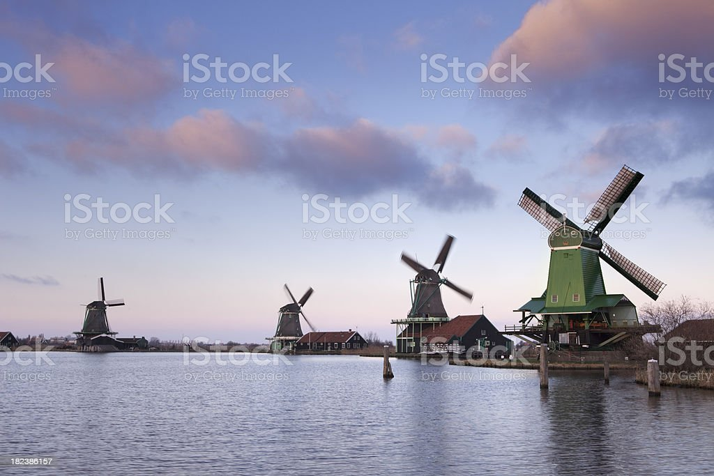 Traditional Dutch windmills at sunrise in Zaanse Schans, The Netherlands royalty-free stock photo