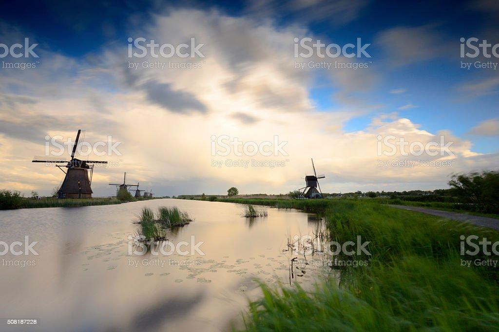 traditional Dutch windmills in a row at Kinderdijk stock photo