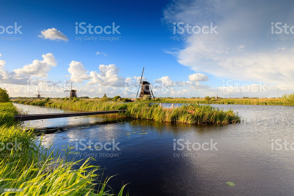 traditional Dutch windmills in a row at Kinderdijk stock photo