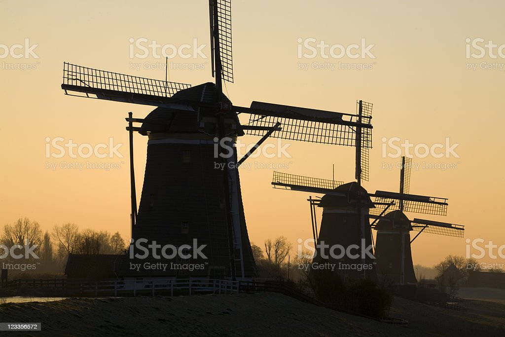 traditional Dutch windmills on a cold winter morning stock photo