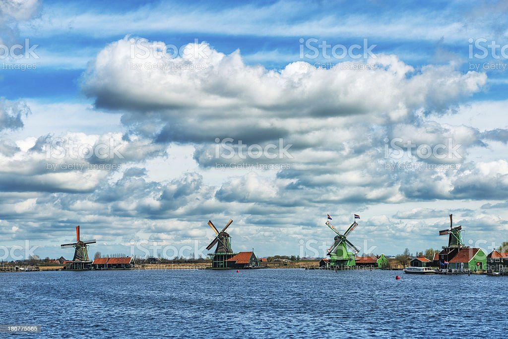 Traditional Dutch Windmills on a Typical Canal in Netherlands royalty-free stock photo