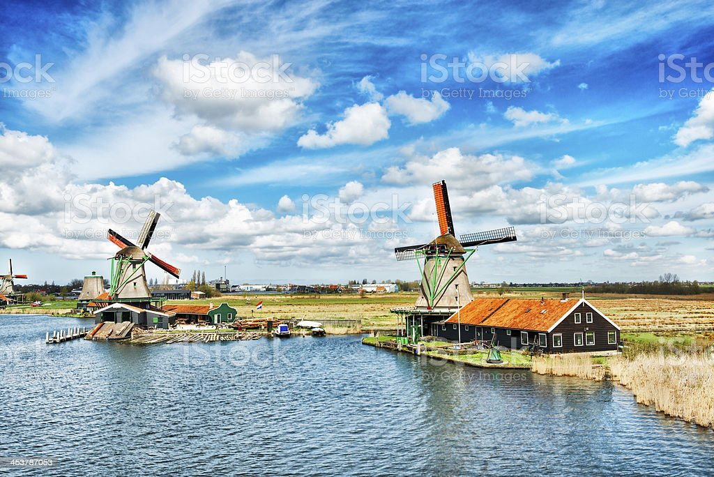 Traditional Dutch Windmills on a Typical Canal in Netherlands stock photo