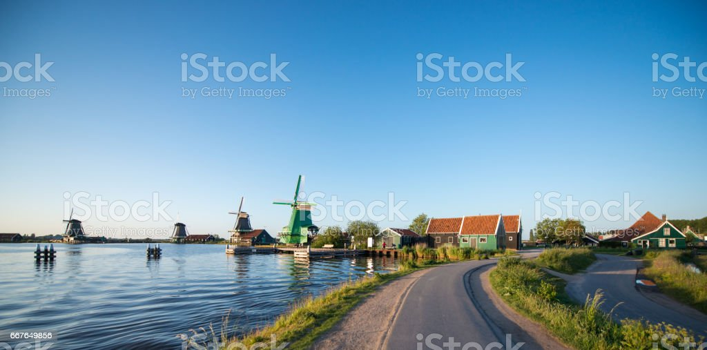 Traditional Dutch windmills with canal close stock photo