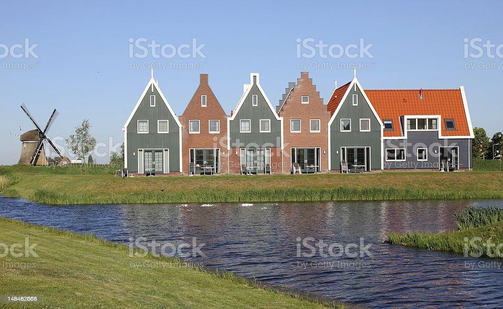 Traditional Dutch wooden houses, idyllic landscape, holland stock photo