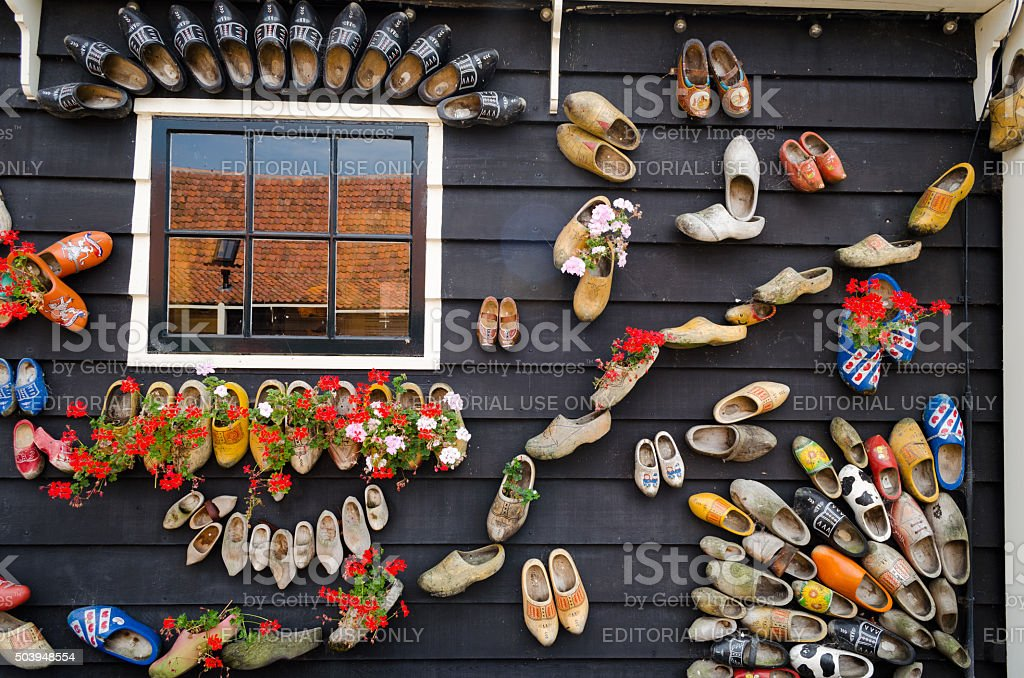 Traditional dutch wooden shoes hanging on a wall as decoration stock photo