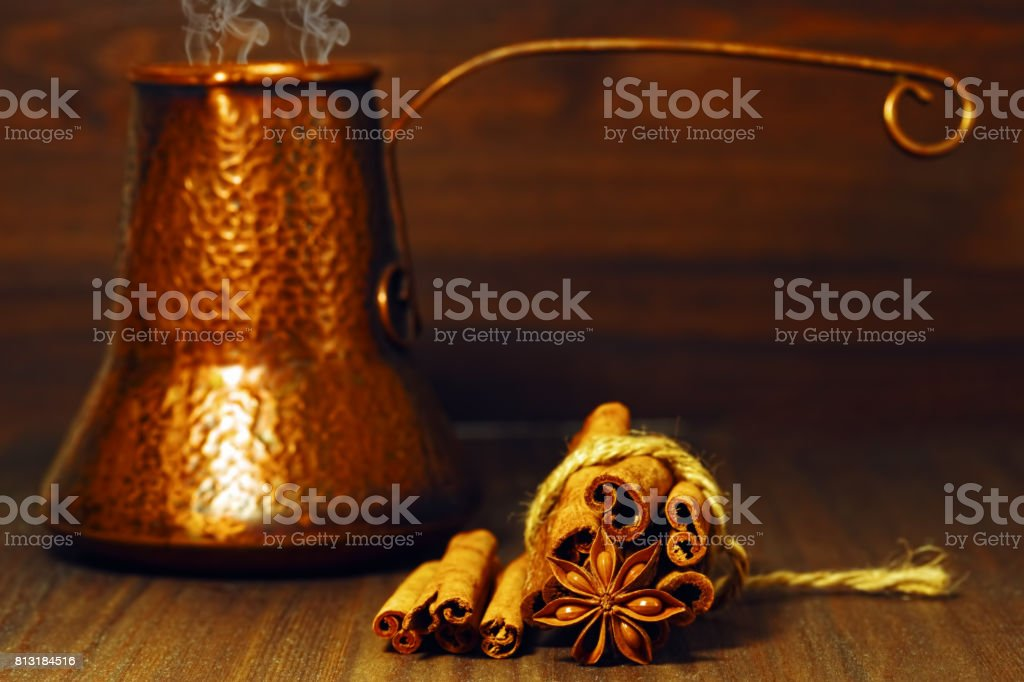 Traditional east coffee pot and spices on the table stock photo