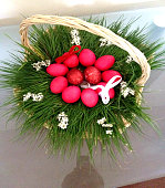 Traditional Easter Basket with red eggs in it