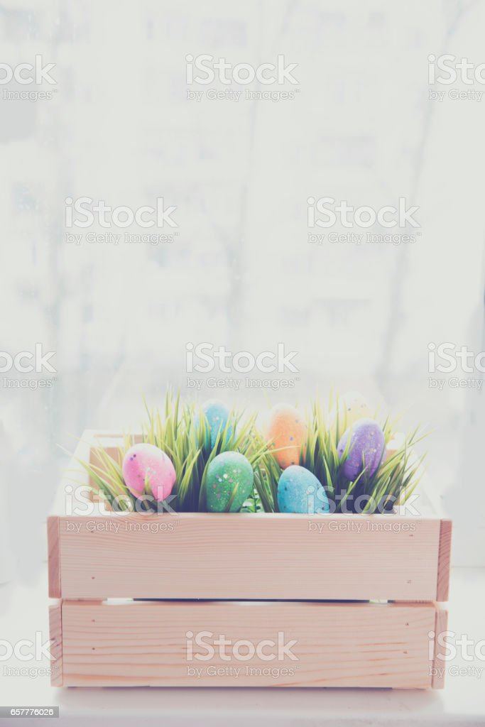 Traditional Easter  eggs inside a wooden crate stock photo