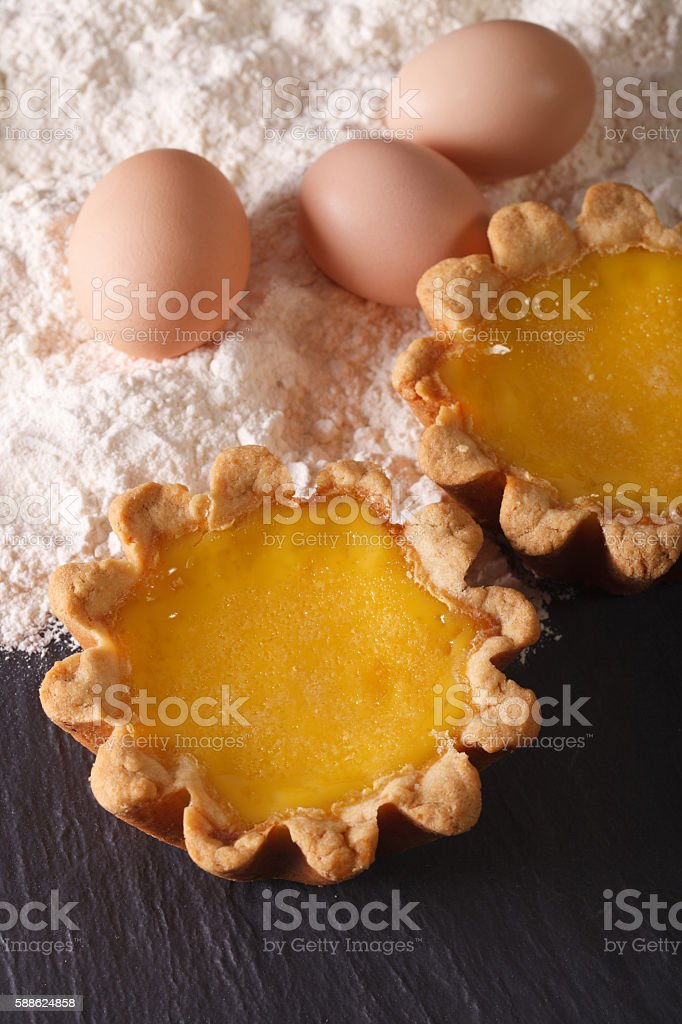Traditional Egg Tart and ingredients close-up. Vertical stock photo
