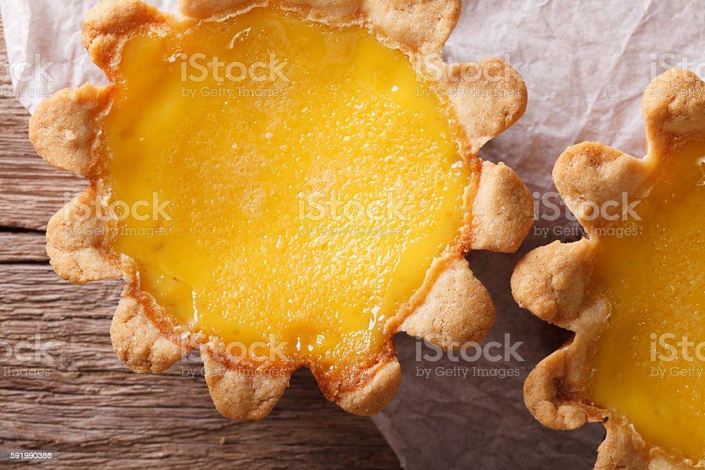 Traditional Egg Tart macro on paper. horizontal top view stock photo
