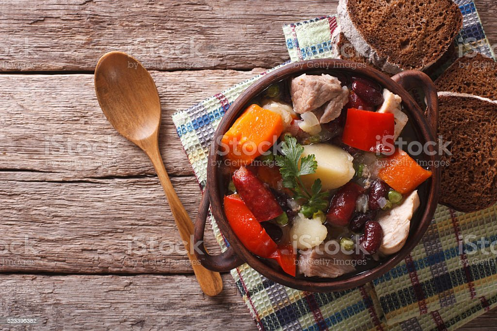 Traditional eintopf soup in the pot on the table. horizontal stock photo