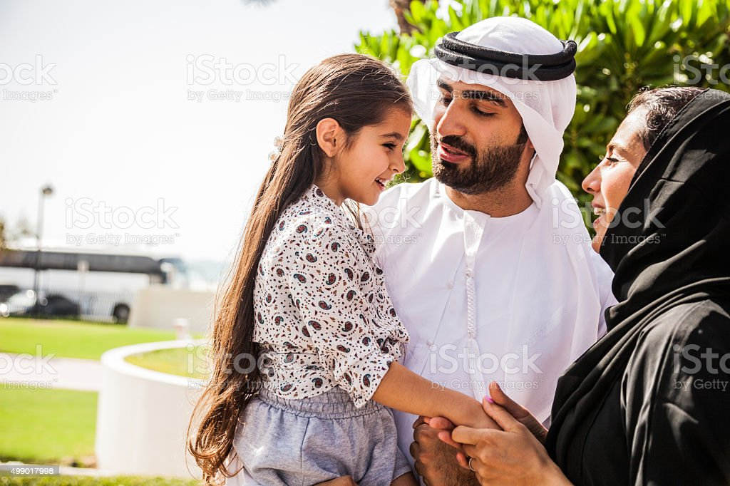 Traditional Emirati young family enjoying weekend stock photo
