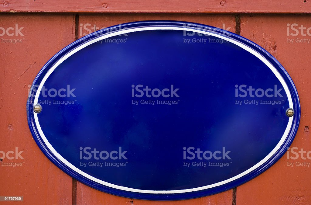 Traditional enamel dark blue oval sign with copy space stock photo