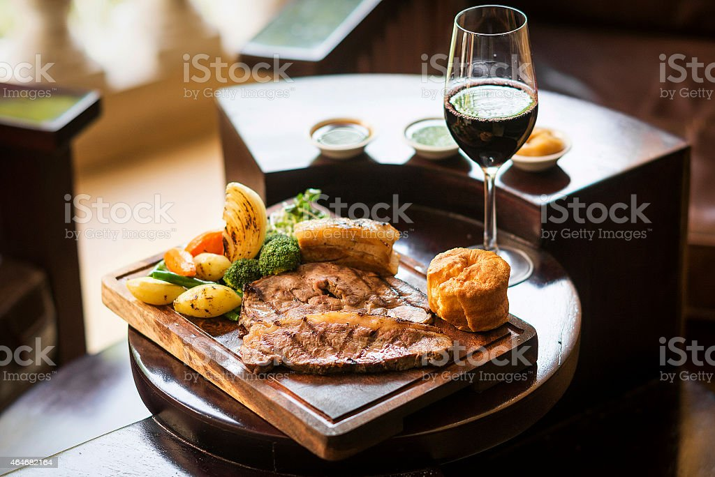 traditional english food sunday roast lunch in restaurant stock photo