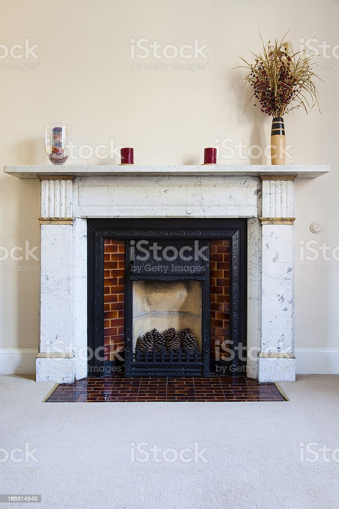Traditional English Marble Fireplace stock photo
