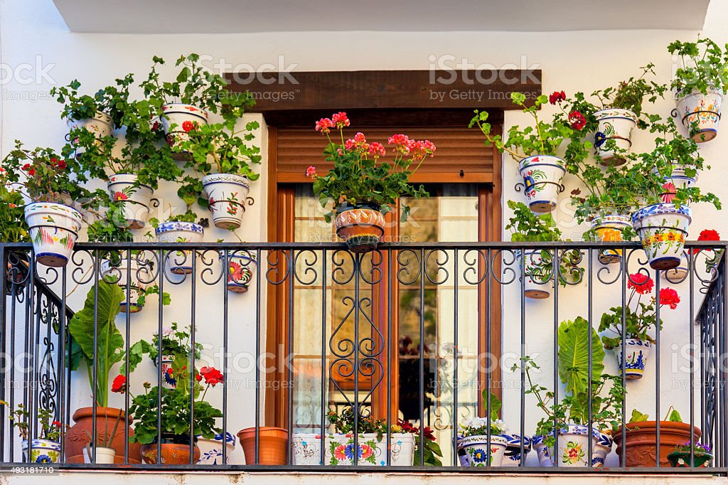 Traditional European Balcony with flowers and flowerpots stock photo
