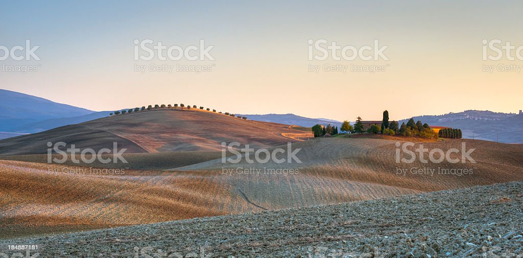 Traditional Farm On Tuscany Hill At Sunset royalty-free stock photo