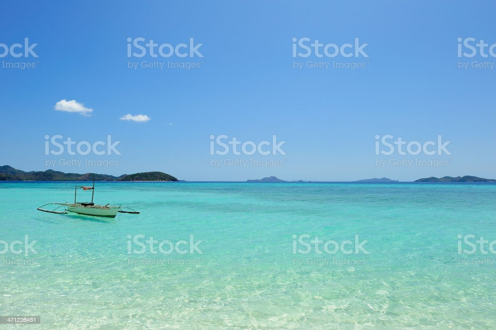 Traditional Filipino boat on the water stock photo