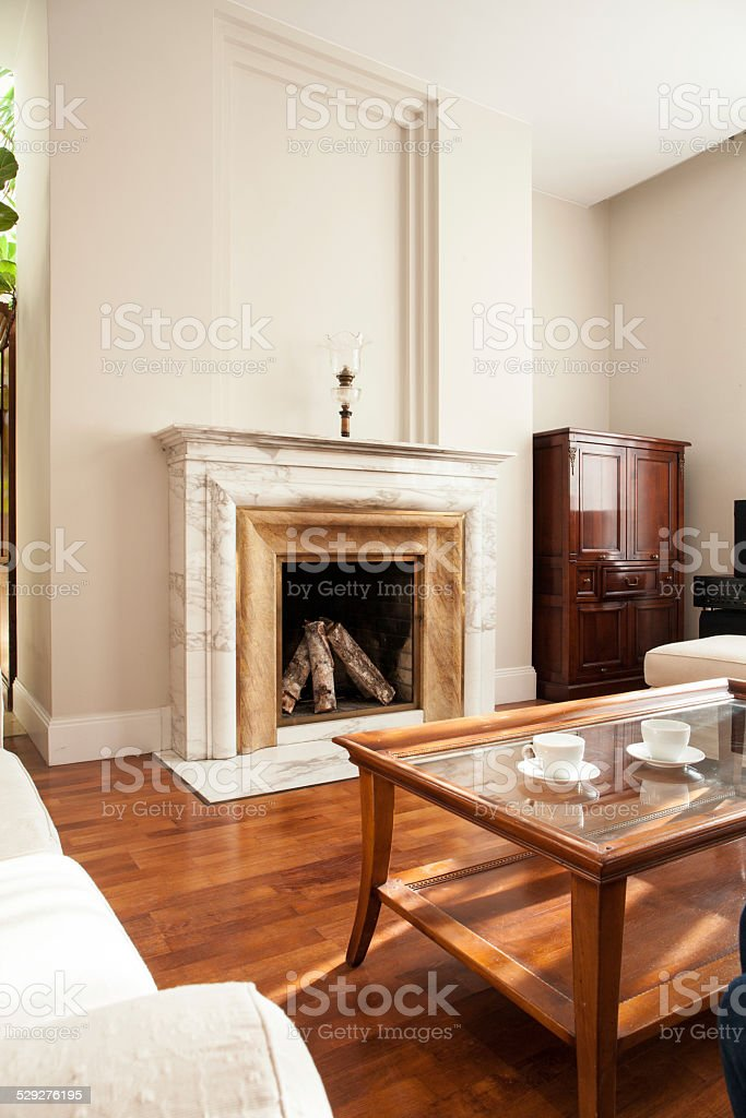 Traditional fireplace in luxury parlour stock photo