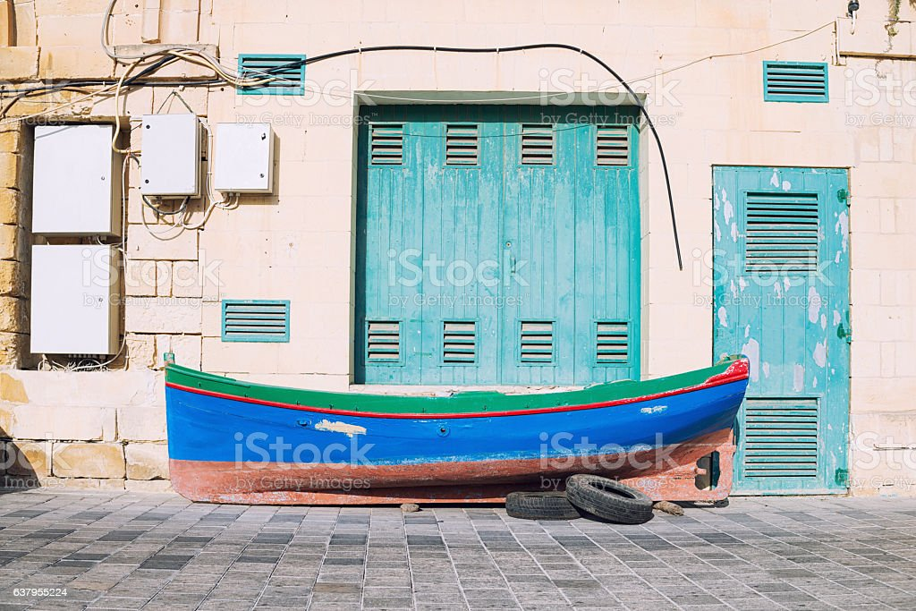 Traditional fisherman boat out of the water stock photo
